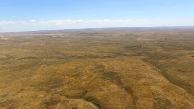AERIAL: Flying over deserted prairies