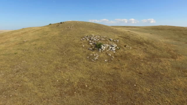 aerial: flying over deserted steppe and hills - prairie stock videos and b-roll footage