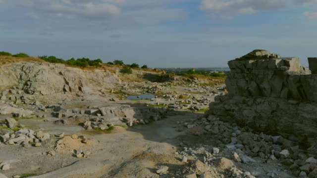 flying over disused rock quarry - quarry stock videos and b-roll footage