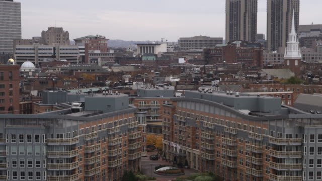 flying over downtown boston toward north end and old north church. shot in 2011. - boston massachusetts stock videos & royalty-free footage