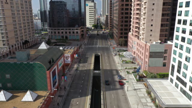 flying over empty downtown street during coronavirus pandemic - dutcheraerials covid stock videos & royalty-free footage
