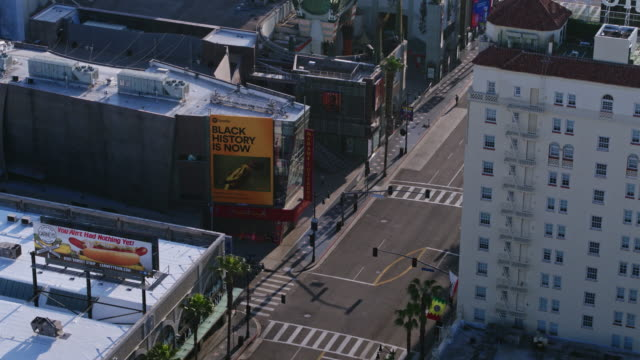 flying over empty hollywood boulevard during coronavirus pandemic - day stock videos & royalty-free footage
