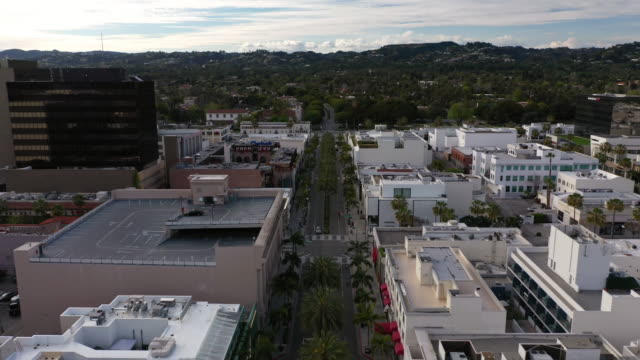 flying over empty rodeo drive in beverly hills during covid-19 pandemic - dutcheraerials covid stock videos & royalty-free footage