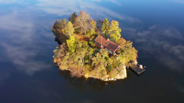 flying over fall lake and island early morning - stockholm stock videos & royalty-free footage