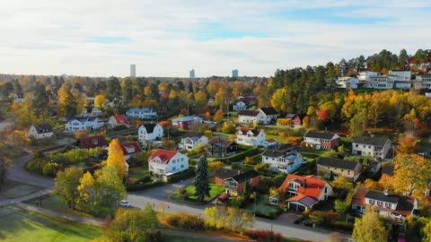 flying over fall lake and villa area edsviken, morning, sollentuna, stockholm - drone point of view stock videos & royalty-free footage