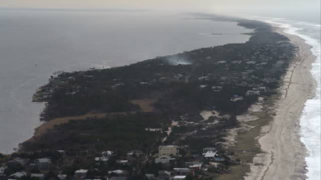 flying over fire island pines, new york. shot in november 2011. - artbeats stock videos & royalty-free footage