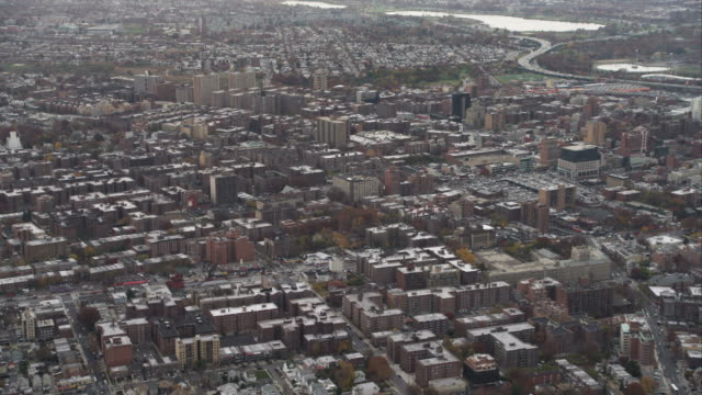 flying over flushing in queens, new york city. shot in november 2011. - flushing queens stock videos and b-roll footage