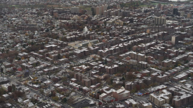 Flying over Flushing in Queens, New York, City, zoom-out to wider view. Shot in November 2011.