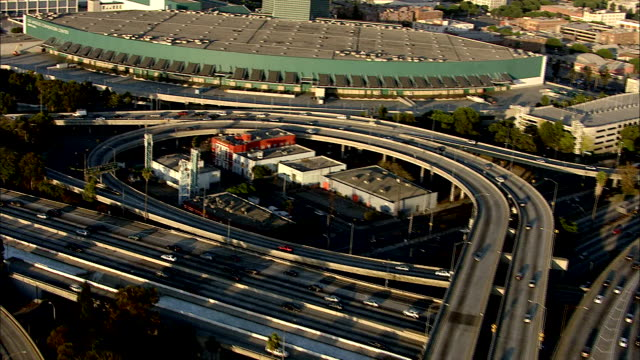 stockvideo's en b-roll-footage met flying over la freeway interchange complex la convention center around la live entertainment complex nokia theater staples center ritzcarlton hotel... - los angeles convention center