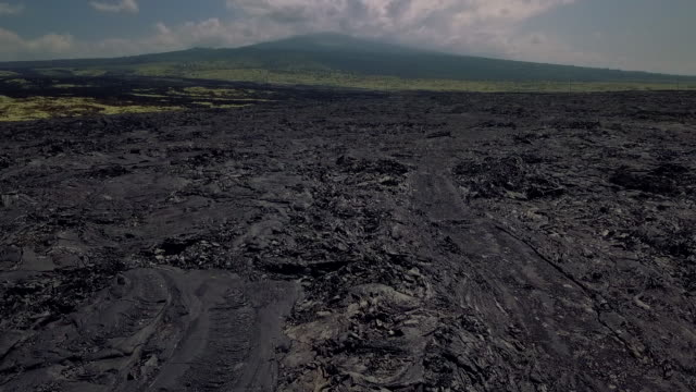 flying over frozen lava of big island of hawaii, usa - frozen stock videos and b-roll footage