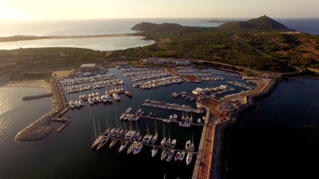 AERIAL: Flying over harbor at sunrise