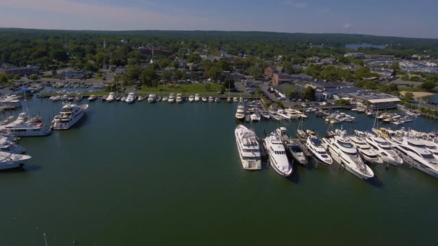 flying over harbor to small town - long island video stock e b–roll