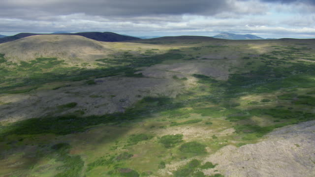 flying over hilly landscape in alaska - hd format stock videos & royalty-free footage
