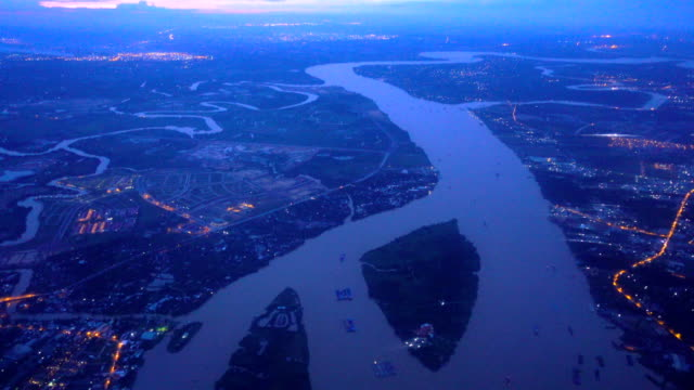 4k flying over ho chi minh city before sunrise - ho chi minh city stock videos & royalty-free footage