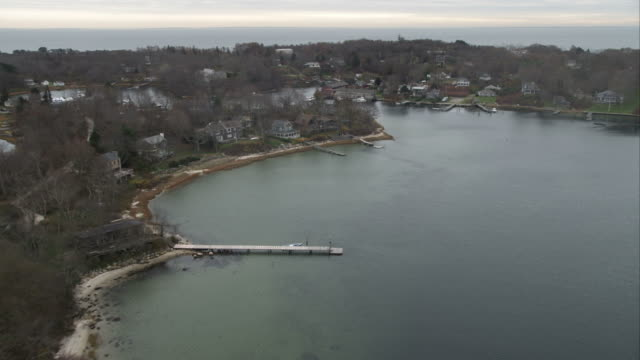 flying over homes along inlets on fishers island, new york. shot in november 2011. - artbeats stock videos & royalty-free footage