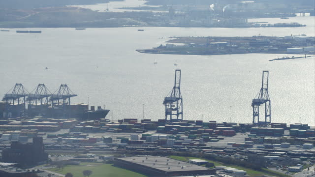 flying over industrial cranes at loading docks in baltimore harbor, maryland. shot in november 2011. - hafen von baltimore stock-videos und b-roll-filmmaterial