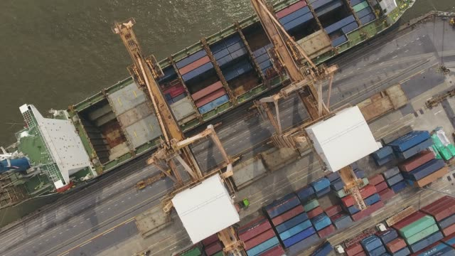 flying over industrial port with containers ship, aerial video - multicopter stock videos & royalty-free footage