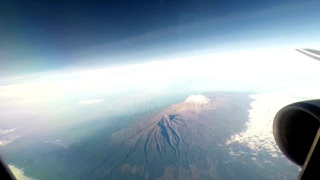 flying over kilimanjaro - mt kilimanjaro stock videos & royalty-free footage