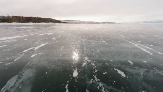 flying over lake baikal - frozen stock videos and b-roll footage