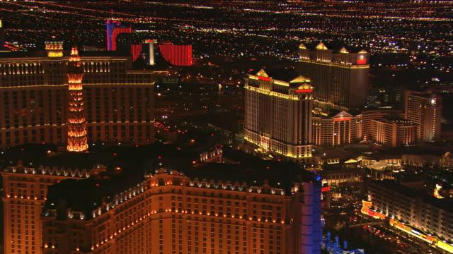 Flying over Las Vegas Strip casinos near Flamingo Avenue at night
