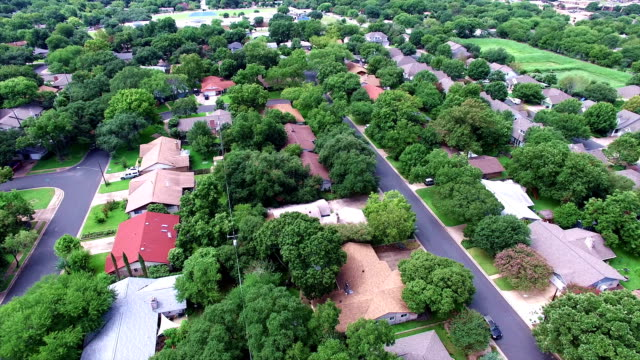 AERIAL: Flying Over Local Austin Texas Housing Complex with natural Trees and Texas Hill Country feel