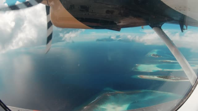 flying over maldives islands with seaplane - propeller aeroplane stock videos & royalty-free footage