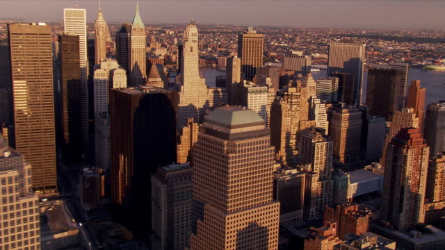 Flying over Manhattan's financial district in afternoon sunshine. Shot in 2006.
