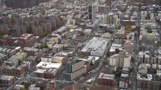 flying over martin luther king boulevard in harlem, new york city. shot in november 2011. - artbeats bildbanksvideor och videomaterial från bakom kulisserna
