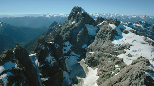 flying over mountain peak in chile - patagonia chile stock videos and b-roll footage