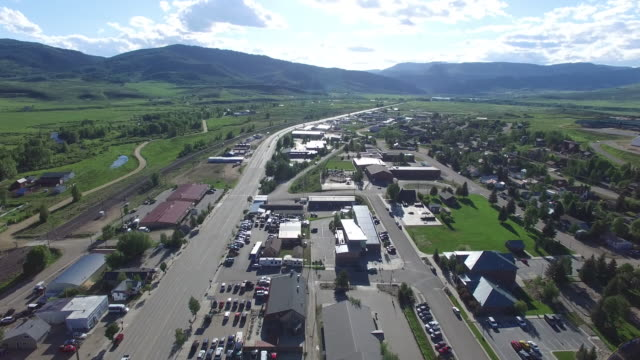 Flying over mountain town into sun,4K, 37s, 3of5, CIty view, Mountain town, Granby Colorado, Fall Colors, Green, Stock Video Sale - Drone Discoveries - drone aerial video city views in 4k beautiful reveal with traffic and homes in view