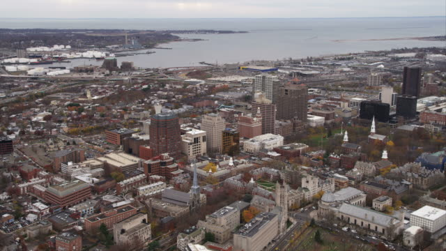 flying over new haven green toward harbor in new haven, connecticut. shot in november 2011. - new haven stock-videos und b-roll-filmmaterial
