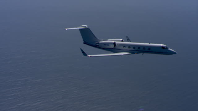 flying over ocean - private jet stock videos & royalty-free footage