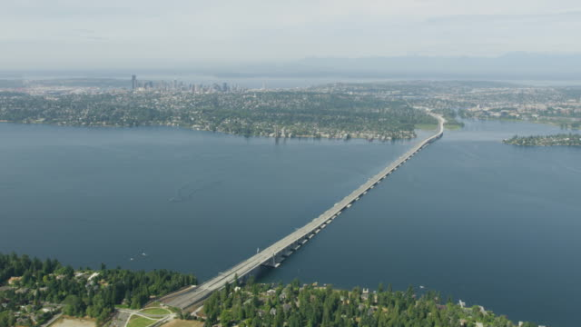 flying over of the evergreen point bridge on the lake washington - evergreen stock videos and b-roll footage