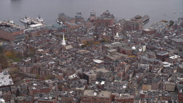 flying over old town boston toward charles river; old north church in lower center frame as clip ends. shot in 2011. - old north church stock videos & royalty-free footage