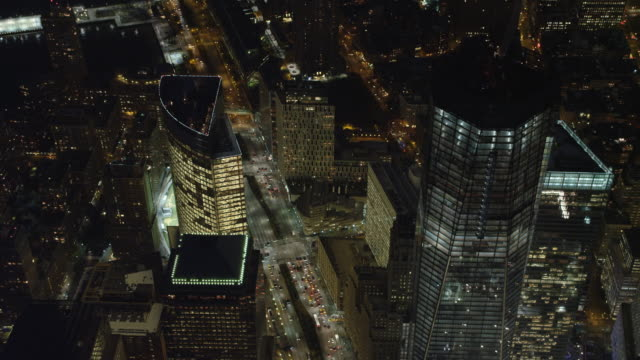 vídeos y material grabado en eventos de stock de flying over one world trade center (freedom tower) in new york city at night, turning to look at ball fields. shot in november 2011. - artbeats