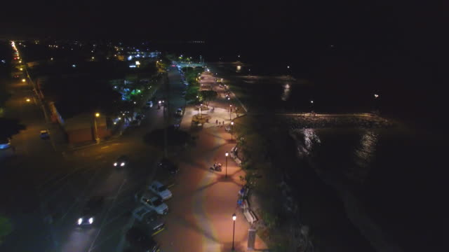 "flying over ""paseo de los turistas"" puntarenas - costa rica - autoscheinwerfer stock-videos und b-roll-filmmaterial"