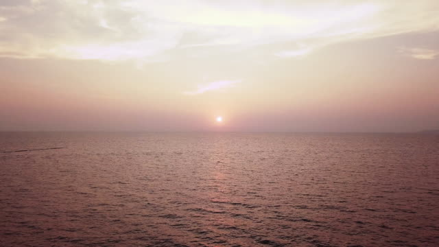 aerial: flying over pattaya beach at sunrise - paesaggio marino video stock e b–roll