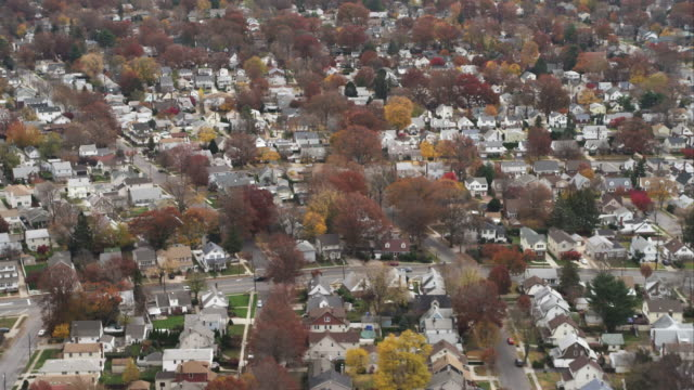 flying over residential area in hempstead, new york. shot in november 2011. - long island video stock e b–roll