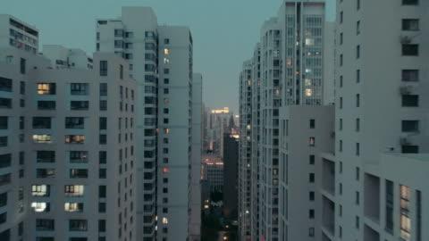 flying over residential buildings - lägenhet bildbanksvideor och videomaterial från bakom kulisserna