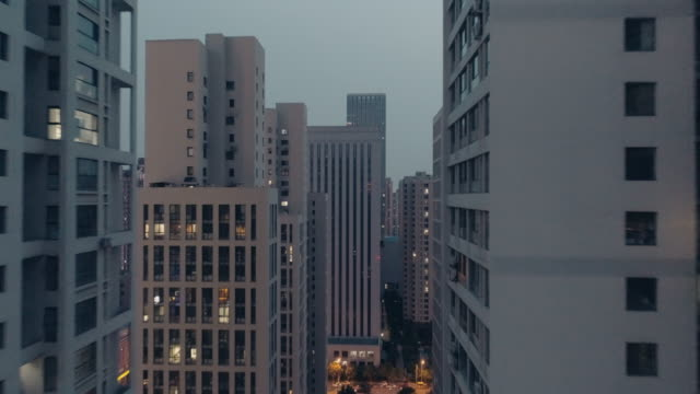flying over residential buildings - aircraft point of view stock videos and b-roll footage
