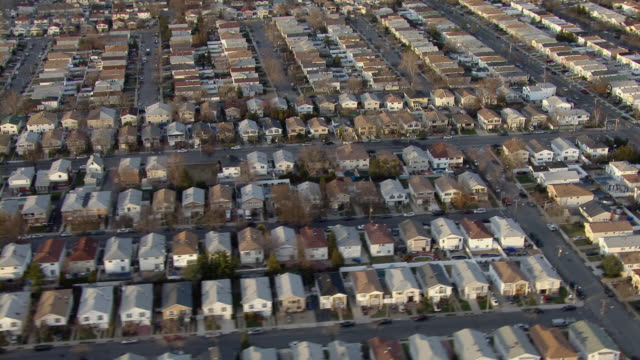 flying over rooftops of suburban neighborhood in staten island, new york city. - staten island stock videos and b-roll footage