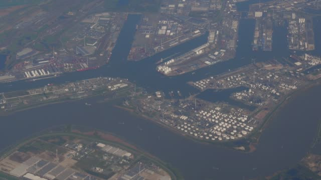 flying over rotterdam port - harbour stock videos & royalty-free footage