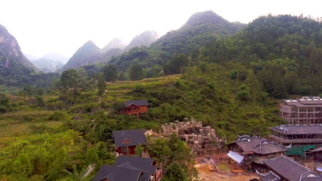 Flying Over Scenic Village in Valley, Guizhou Province, China. Aerial video