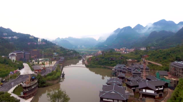 Flying Over Scenic Village in Valley with River, Guizhou Province, China. Aerial video