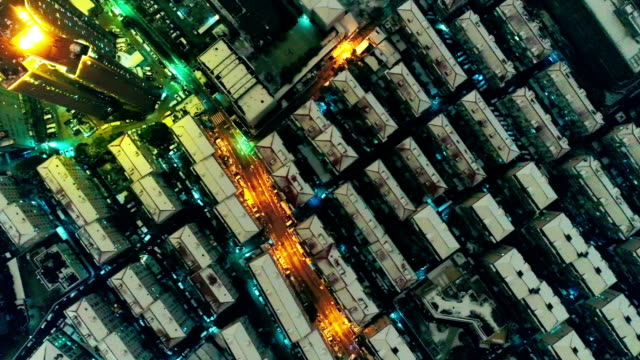 Flying over shanghai residential district in a snowing night