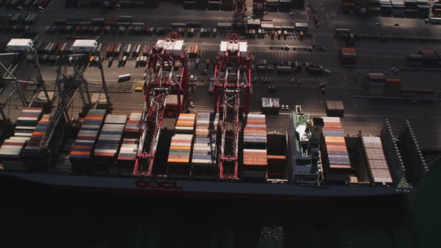 flying over shipping containers and loading cranes at a dock in port of long beach, los angeles. shot in 2010. - artbeats stock videos & royalty-free footage
