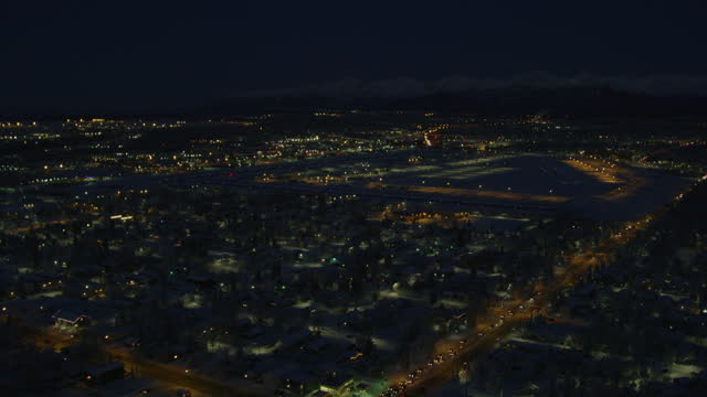 flying over shot of a suburban area of  anchorage at night - anchorage alaska stock videos & royalty-free footage