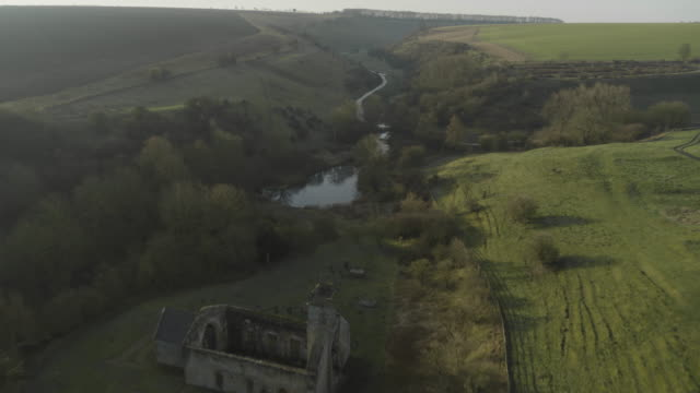 flying over shot of the archeological sites of wharram percy - pond stock videos & royalty-free footage