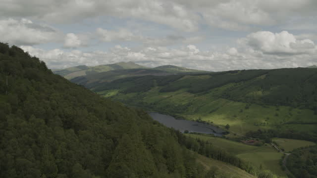 flying over shot of the hilly terrain and dubh loch - coastal feature stock videos & royalty-free footage