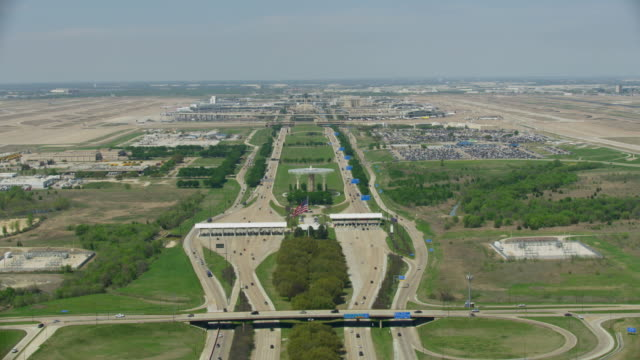 flying over shot of the international parkway - dallas fort worth airport stock videos & royalty-free footage